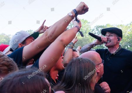 Stock Photo of Alexander Martin Barr (R) of the Irish-US folk-punk-band Dropkick Murphys performs on park stage at the 'Rock im Park' festival in Nuremberg, Germany, 07 June 2019. The festival takes place from 07 to 09 June.