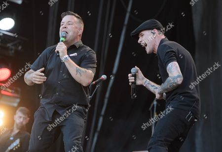 Ken Casey (L) and Alexander Martin Barr of the Irish-US folk-punk-band Dropkick Murphys perform on park stage at the 'Rock im Park' festival in Nuremberg, Germany, 07 June 2019. The festival takes place from 07 to 09 June.