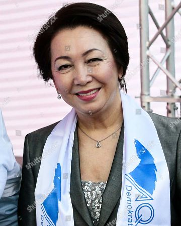 Kazakhstan's Daniya Espayeva, a female candidate in presidential elections poses for a photo as she meets with supporters in Nur-Sultan, the capital city of Kazakhstan, . For the first time in nearly three decades of independence, Kazakhstan is holding a presidential election on upcoming Sunday, without Nursultan Nazarbayev on the ballot