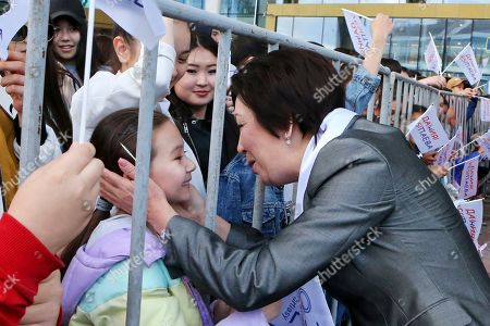 Kazakhstan's Daniya Espayeva, a female candidate in presidential elections greets supporters in Nur-Sultan, the capital city of Kazakhstan, . For the first time in nearly three decades of independence, Kazakhstan is holding a presidential election on upcoming Sunday without Nursultan Nazarbayev on the ballot