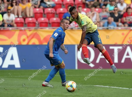 Ukraine's Viktor Korniienko, left, tries to block a shot from Colombia's Luis Sandoval during the quarter final match between Colombia and Ukraine at the U20 World Cup soccer in Lodz, Poland