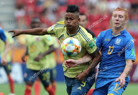 Ukraine's Yukhym Konoplia, right, duels for the ball with Colombia's Luis Sandoval, left, during the quarter final match between Colombia and Ukraine at the U20 World Cup soccer in Lodz, Poland