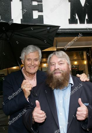 Stock Image of Simon Williams and Brian Blessed promote the Mills production of Singing In The Rain
