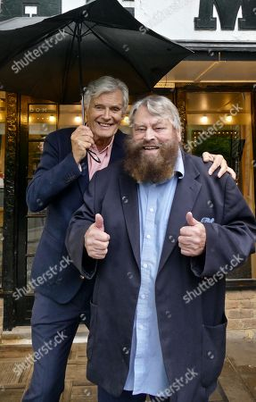 Stock Picture of Simon Williams & Brian Blessed promote the Mills production of Singing In The Rain