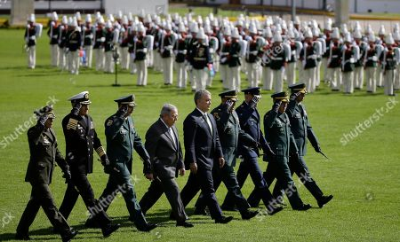 Gen. Oscar Atehortua, Admiral Evelio Ram'rez, Gen. Nicacio Mart'nez, Guillermo Botero, Ivan Duque, Gen. Luis Fernando Navarro, Gen. Ramses Rueda, Gen. Juan Bautista Yepes. Colombia's President Ivan Duque, center, walks with his armed forces chiefs of staff, from left, National Police Commander Gen. Oscar Atehortua, Navy Commander Admiral Evelio Ramírez, Army Commander Gen. Nicacio Martínez, Defense Minister Guillermo Botero, Armed Forces Commander Gen. Luis Fernando Navarro, Air Force Commander Gen. Ramses Rueda, Armed Forces Chief of Staff Gen. Juan Bautista Yepes, as they review the troops during a military ceremony in Bogotá, Colombia, on