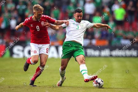 Denmark vs Republic of Ireland. Ireland's Enda Stevens with Nicolai Jorgensen of Denmark