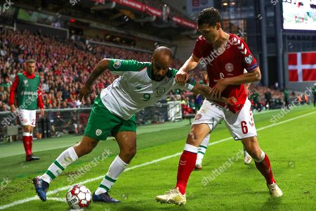 Stock Photo of Denmark vs Republic of Ireland. Ireland's David McGoldrick and Andreas Christensen of Denmark
