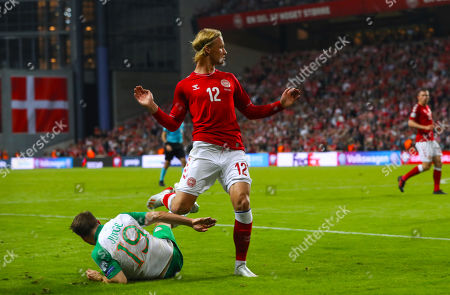 Denmark vs Republic of Ireland. Ireland's Alan Judge goes down injured after a coming together with Kasper Dolberg of Denmark