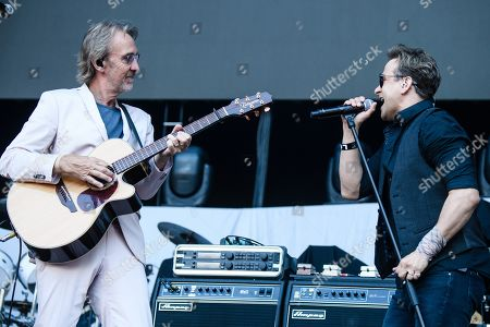 Stock Photo of British gitarrist Mike Rutherford (L) and Canadian singer Tim Howar perform with the band Mike and the Mechanics on stage as an opener for Phil Collins' 'Not Dead Yet' tour, in Berlin, Germany, 07 June 2019.