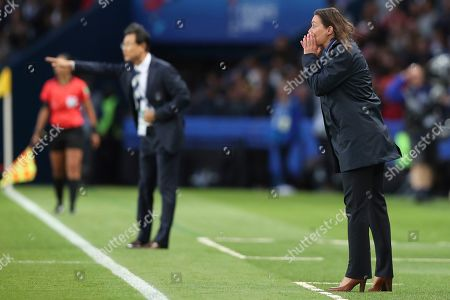 France coach Corinne Diacre, right gives directions to her team during the Group A soccer match between France and South Korea on the occasion of the Women's World Cup at the Parc des Princes in Paris