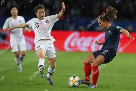 Stock Picture of South Korea's Kang Chae-rim, left, and France's Eve Perisset vie for the ball during the Group A soccer match between France and South Korea on the occasion of the Women's World Cup at the Parc des Princes in Paris