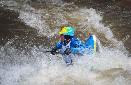 Stock Picture of Stephen Wright in semi-final action during the GoPro Mountain Games freestyle kayak competition. Adventure athletes from around the world gather in Vail, Colorado each summer for North America's largest celebration of adventure sports competition, art, and music. Vail, Colorado