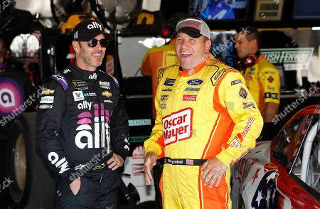 Jimmie Johnson, Ryan Newman. Jimmie Johnson, left, meets with Ryan Newman in the garage before practice for a NASCAR cup series auto race at Michigan International Speedway, in Brooklyn, Mich