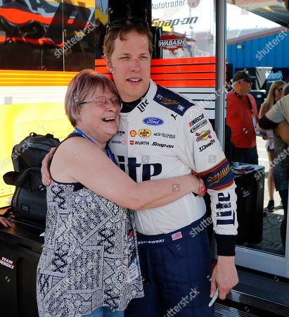 Stock Photo of Brad Keselowski, Sue Wangler. Race fan Sue Wangler hugs Brad Keselowski for a photo after a practice session for the NASCAR cup series race at Michigan International Speedway, in Brooklyn, Mich. Wangler had Keselowski in her day care and was his neighbor