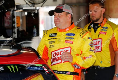 Ryan Newman enters his car before a practice session for the NASCAR cup series race at Michigan International Speedway, in Brooklyn, Mich