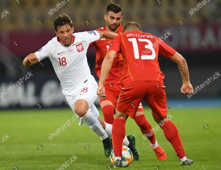 Poland's Bartosz Bereszynski (L) in action against North Macedonia's Stefan Ristovski (R) and Egzon Bejtulai (C) during the UEFA EURO 2020, Group G qualifying soccer match between North Macedonia and Poland, in Skopje, North Macedonia, 07 June 2019.