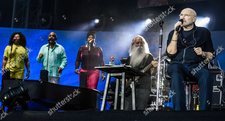 Phil Collins (R) performs next to bassist Leland Sklar (4-L) on stage during a concert in Berlin, Germany, 07 June 2019, as part of his 'Not Dead Yet' tour.