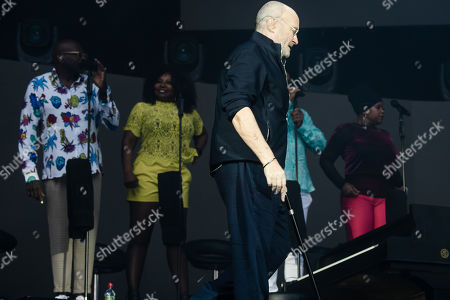 Phil Collins arrives with a walking aid to perform on stage during a concert in Berlin, Germany, 07 June 2019, as part of his 'Not Dead Yet' tour.
