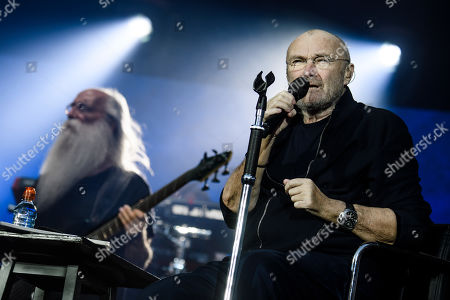 Phil Collins (R) performs next to bassist Leland Sklar (L) on stage during a concert in Berlin, Germany, 07 June 2019, as part of his 'Not Dead Yet' tour.