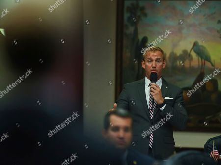 Michael Grieco, James Grant. At right, Rep. Michael Grieco, D-Miami Beach, asks a question to Rep. James Grant, R-Tampa, left, during debate over Grant's House Bill 7089 - Voting Rights Restoration, in the Florida House of Representatives in Tallahassee, Fla
