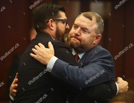 Manny Diaz, Rob Bradley. Sen. Manny Diaz, Jr., R-Hialeah, and Sen. Rob Bradley, R-Fleming Island, hug after the vote on Diaz's Senate Bill 7030: Implementation of Legislative Recommendations of the Marjory Stoneman Douglas High School Public Safety Commission, which will give teachers the option to be armed, in the Florida Senate in Tallahassee, Fla. The bill passed 22-17