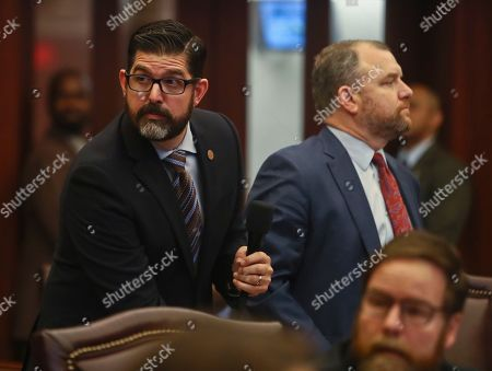 Manny Diaz, Rob Bradley. Sen. Manny Diaz, Jr., R-Hialeah, and Sen. Rob Bradley, R-Fleming Island, watch the vote on Diaz's Senate Bill 7030: Implementation of Legislative Recommendations of the Marjory Stoneman Douglas High School Public Safety Commission, which will give teachers the option to be armed, in the Florida Senate in Tallahassee, Fla. The bill passed 22-17