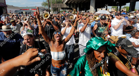Stock Photo of People participate in a second line parade in honor of famed New Orleans musician Mac 'Dr John' Rebennack, who passed away Thursday, in New Orleans