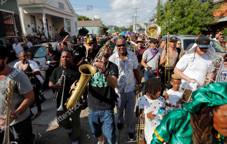 People participate in a second line parade in New Orleans, in honor of famed New Orleans musician Mac 'Dr John' Rebennack, who passed away Thursday