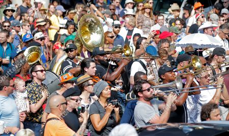 Stock Image of People participate in a second line parade in New Orleans, in honor of famed New Orleans musician Mac 'Dr John' Rebennack, who passed away Thursday