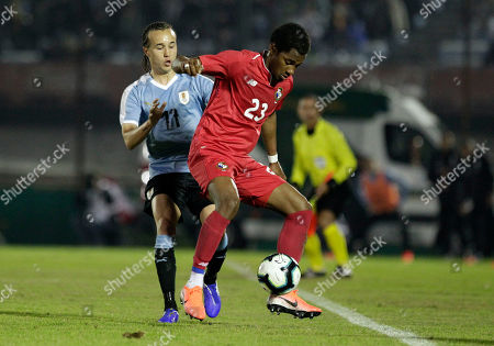 Michael Murillo of Panama, front, controls the ball against Diego Laxalt of Uruguay, during a pre-Copa America friendly soccer match in Montevideo, Uruguay, . Brazil will host the Copa America tournament, which runs from June 14 through July 7