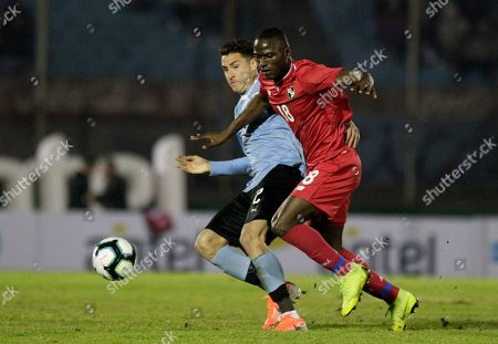 Stock Image of Jose Giménez of Uruguay, left, fights for the ball with Abdiel Arroyo of Panama during a pre-Copa America friendly soccer match in Montevideo, Uruguay, . Brazil will host the Copa America tournament, which runs from June 14 through July 7