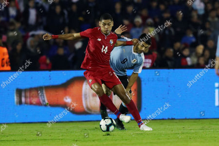 Stock Picture of Uruguay's Luis Suarez (R) vies for the ball with Panama's Valentin Pimentel (L) during an international friendly soccer match between Uruguay and Panama at Centenario stadium in Montevideo, Uruguay, 07 June 2019.