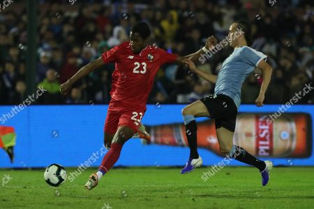Uruguay's Diego Laxalt (R) vies for the ball with Panama's Michael Murillo (L) during an international friendly soccer match between Uruguay and Panama at Centenario stadium in Montevideo, Uruguay, 07 June 2019.