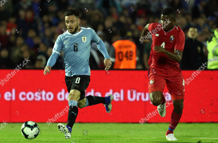 Uruguay's Nahitan Hernandez (L) vies for the ball with Panama's Fidel Escobar (R) during an international friendly soccer match between Uruguay and Panama at Centenario stadium in Montevideo, Uruguay, 07 June 2019.