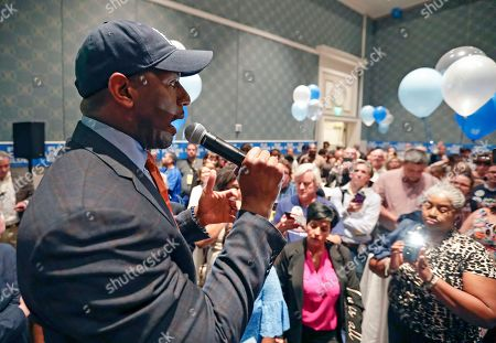 Former Florida Democratic gubernatorial nominee Andrew Gillum speaks to supporters during a gathering at the Florida Democratic Party state conference, in Orlando, Fla