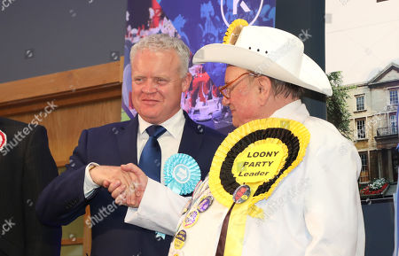 "Stock Image of Mike Greene (Brexit Party candidate) shakes hands with Alan ""Howling Laud"" Hope (Official Monster Raving Loony Party Candidate) at the declaration. The by-election was held in Peterborough today after disgraced MP Fiona Onasanya was removed from her post as Peterborough MP when over 19,000 signed a recall petition, following her court appearance over a speeding ticket, and her spell in jail."