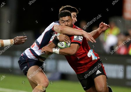 Stock Image of Crusaders Richie Mo'unga is tackled by Melbourne Rebels' Jack Maddocks during the Super Rugby match between the Crusaders and the Melbourne Rebels in Christchurch, New Zealand