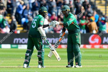 100 - Shakib Al Hasan (vc) of Bangladesh is congratulated by Mohammad Mahmudullah Riyad of Bangladesh after scoring a century during the ICC Cricket World Cup 2019 match between England and Bangladesh the Cardiff Wales Stadium at Sophia Gardens, Cardiff