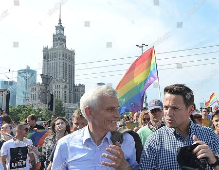 Warsaw Mayor Rafal Trzaskowski, right, and former Warsaw Mayor Marcin Swiecicki, speak as they walk during the gay pride parade, in Warsaw, Poland,. It brought thousands of people to the streets of Warsaw at a time when the LGBT rights movement in Poland is targeted by hate speeches and a government campaign depicting it as a threat to families and society