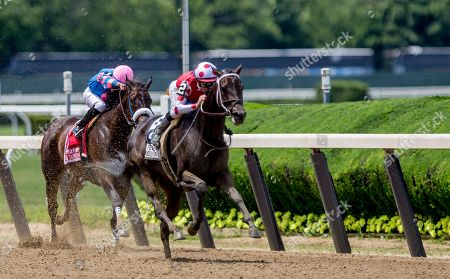 Elmont, NY, U.S. - , #2, Midnight Bisou, ridden by jockey Mike Smite, wins the Ogden Phipps Stakes on Belmont Stakes Festival Saturday at Belmont Park in Elmont, New York. Kaz Ishida/Eclipse Sportswire/CSM