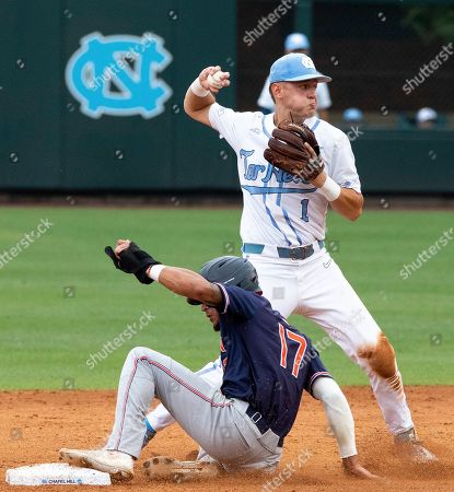 Auburn's Will Holland (17) slides into second as North Carolina's Danny Serretti (1) completes a double-play during Game 1 at the NCAA college baseball super regional tournament in Chapel Hill, N.C