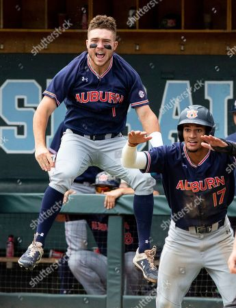 Auburn's Judd Ward (1) and Will Holland (17) celebrate as they take the lead over North Carolina during Game 1 at the NCAA college baseball super regional tournament in Chapel Hill, N.C