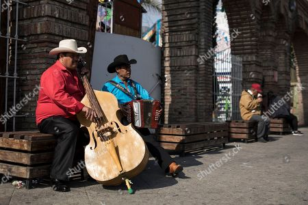 "Musicians perform near the plaza where Mexican President Andres Manuel Lopez Obrador will hold a rally, in Tijuana, Mexico, . Mexican President Andres Lopez Obrador is to hold a rally in Tijuana even as President Trump has put on hold his plan to begin imposing tariffs on Mexico on Monday, saying the U.S. ally will take ""strong measures"" to reduce the flow of Central American migrants into the United States"