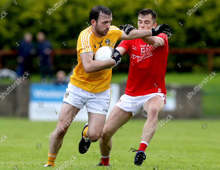 Louth vs Antrim. Antrim's Patrick Gallagher tackles Andy McDonnell of Louth
