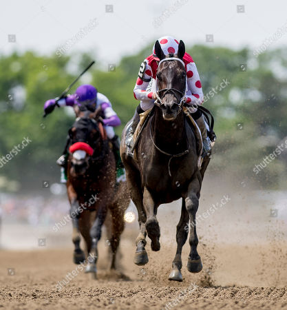 Elmont, New York, U.S. - #2, Midnight Bisou, ridden by jockey Mike Smite, wins the Ogden Phipps Stakes on Belmont Stakes Festival Saturday