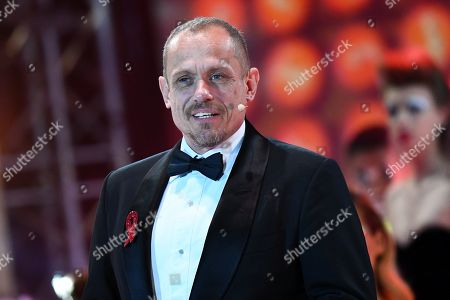 Stock Image of 'Life Ball' charity event organizer Gery Keszler speaks on stage during the opening ceremony at the Rathaus city hall square in Vienna, Austria, 08 June 2019. The 26th Life Ball is a charity fundraiser for HIV and Aids projects.