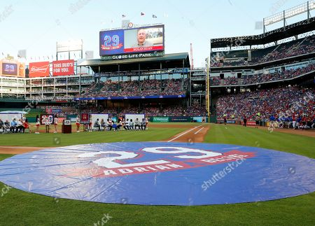 Hall of Famer Nolan Ryan (on videoboard) congratulates retired player Adrian Beltre on the retirement of his jersey during a ceremony before the second baseball game of a doubleheader against the Oakland Athletics in Arlington, Texas