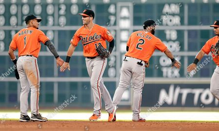 Baltimore Orioles Richie Martin (1), Stevie Wilkerson (12), Jonathan Villar (2) and Keon Broxton, right, celebrate their win over the Houston Astros in a baseball game, in Houston