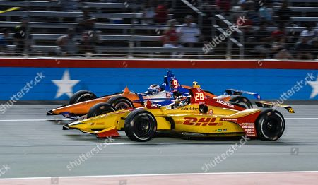 Ryan Hunter-Reay (28) and Scott Dixon (9) battle for position during the IndyCar auto race at Texas Motor Speedway, in Fort Worth, Texas