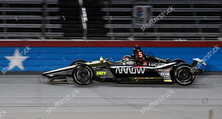 James Hinchcliffe races down the front stretch during the IndyCar auto race at Texas Motor Speedway, in Fort Worth, Texas